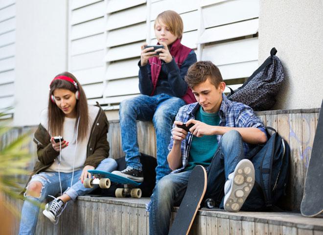 Teens using smartphones